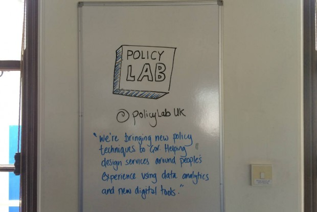 Picture of Policy Lab logo on a whiteboard with 'mission' text beneath