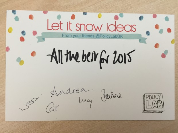 A notecard is pictured reading 'let it snow ideas' with colorued snow dots on the top half of the card. It says 'all the best for 2015' and is signed by Andrea, Beatrice, Cat, Lucy and Lisa