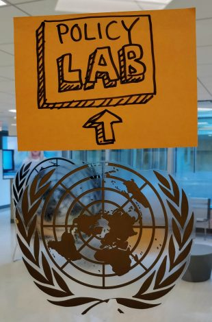 A picture of the Policy Lab logo (a square with 'Policy Lab' written within) alongside the UN logo in a pop up setting.