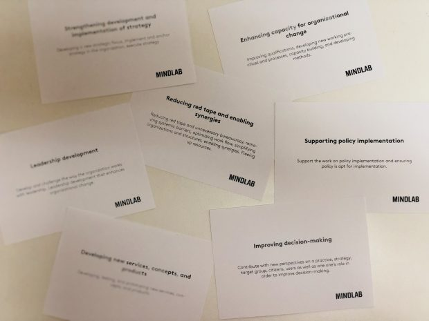 A picture of some cards, produced by 'Mindlab' which ask questions about how we evaluate ourselves