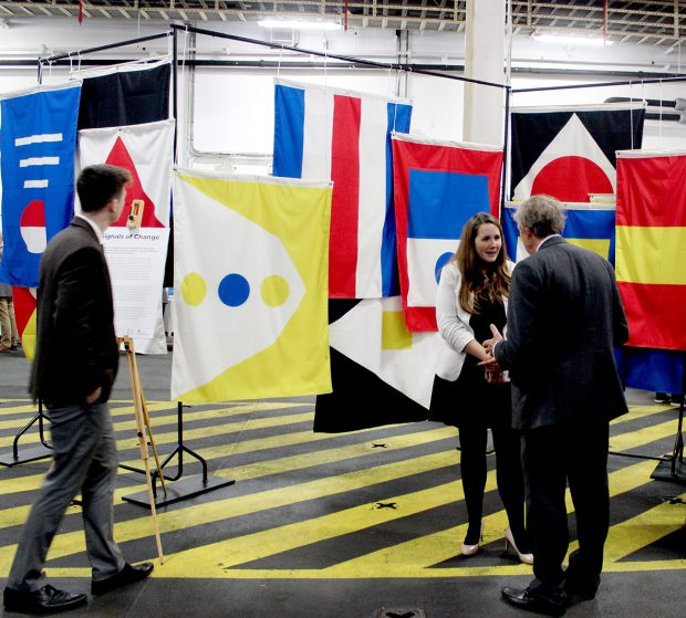 This is an image of policy makers and industry stakeholders discussing the speculative flag installation at London International Shipping Week 2019.