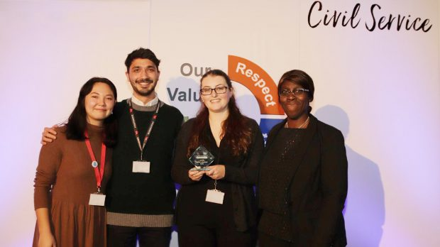 This is an image of the Policy Lab team, Nina Cutler and Sanjan Sabherwal, receiving the Cabinet Office Innovator Award from Carol Bernard with the policy lead Alice Weavers from the DCMS Youth Policy Team.
