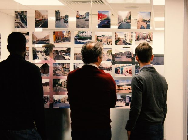 This is an image of workshop participants looking at a wall of crowd-sourced photos at a Policy Lab event on street design at the Chartered Institute of Highways and Transportation in 2019.
